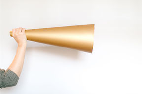 large gold horn as metaphor for how to find your voice as a writer