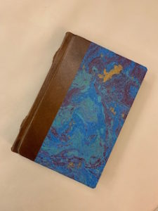 Italian writing journal with marbled paper and leather binding