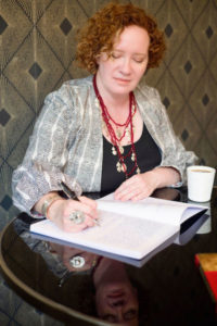 Rhonda writing in coffee shop importance of accountability for writers
