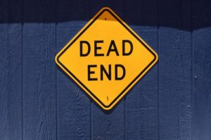 how writers can beat perfectionism yellow Dead End sign on blue fence