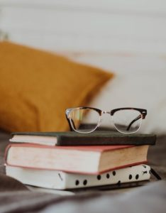 More Reading and Writing glasses on stack of books