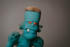 a sad blue Frankenstein monster to illustrate fear of failure