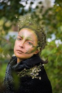 Woman painted as tree to show How Fantasy Authors Can Teach You About Character Development