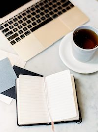 how to manage a book project laptop notebook and coffee