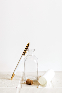 what to write next clear glass jar with paper pen and cork stopper