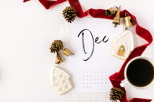 calendar with red ribbon and bells December writing plans