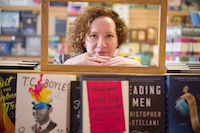 author looking directly at camera in bookstore do you need a literary agent