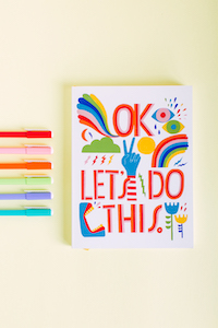 colorful journal and pens how to get out of your own way