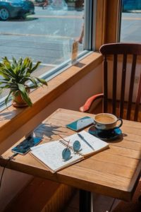 notebook open with coffee on sunny table the notebook project #thenotebookproject