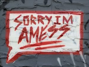 """sign in red text says """"Sorry I'm a Mess"""" First Book Finish Rules of the Draft"""