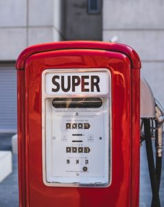 red gas pump says Super your writing life metaphor